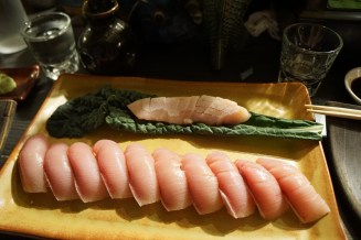 Japanese Yellowtail Nigiri and Sashimi with one piece for everyone at the bar