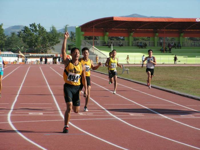 Jomar Udtohan of NCR wins the 400m at the expense of his team mate Jaime Mejia.