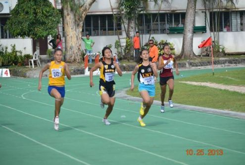 Salcedo in the centre, battles Josie Malacad yellow and Eloiza Luzon blue shorts in the 200m Dash at Uni Games.