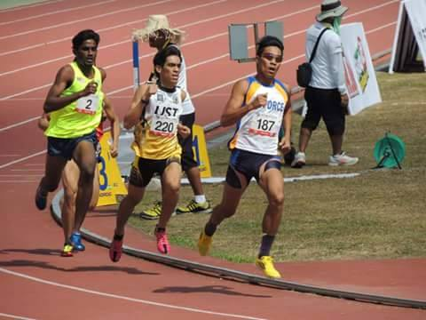 Marco Vilog charges away from the rest of the pack to win his first national title in the 800m.