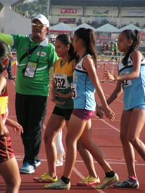 Divingracia leads her team mate Bejoy off the track. Photo Credit: Copyright 2015 Airnel T. Abarra pinoyathletics.info