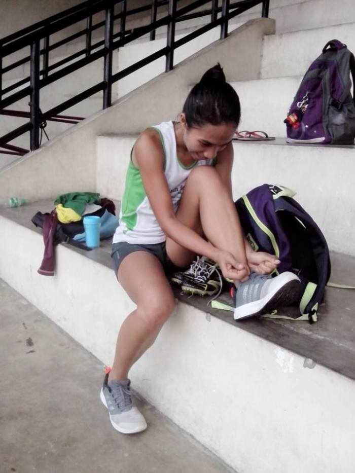 Jinky Obanon doing up her shoes at the weekly relays.