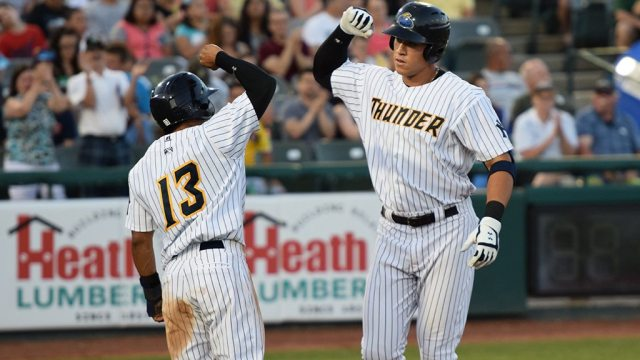 Ali Castillo, left, congratulates Aaron Judge after a homer when both played for the Trenton Thunder in 2015 (Robert M. Pimpsner).