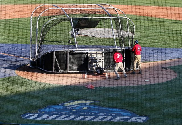 The grounds crew prepares the field at ARM & HAMMER Park in Trenton for an evening game between the Trenton Thunder and Portland Sea Dogs on Wednesday, April 13, 2016. Photo by Martin Griff