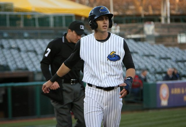 Trenton Thunder centerfielder Dustin Fowler heads to the dugout after being tagged out at home to end the first inning against the Portland Sea Do at ARM & HAMMER Park in Trenton on Wednesday, April 13, 2016. Photo by Martin Griff
