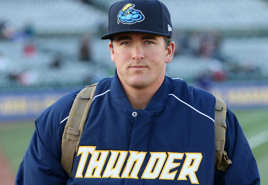 Trenton Thunder pitcher Jonathan Holder walks to the bullpen before a game against the Portland Sea Dogs at ARM & HAMMER Park in Trenton on Wednesday, April 13, 2016. As the most recent pitcher to join the team, he is following tradition and carrying a backpack full of snacks for the other pitchers. Photo by Martin Griff
