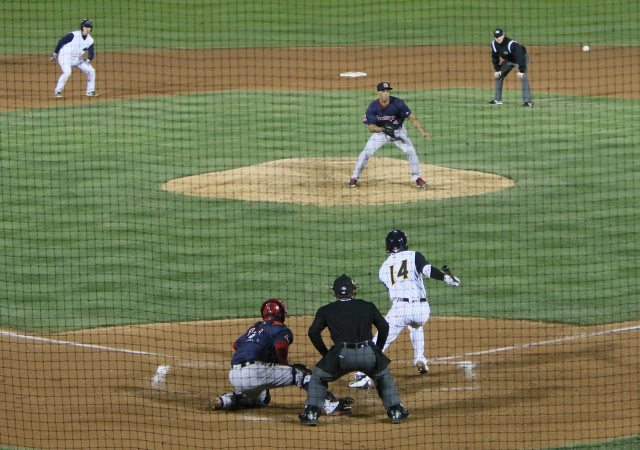 Trenton Thunder's Tyler Wade grounds out, moving Kyle Higashioka to third base in the bottom of the 7th inning against the Portland Sea Dogs at ARM & HAMMER Park in Trenton on Wednesday, April 13, 2016. Photo by Martin Griff