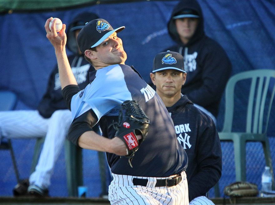 Trenton Thunder southpaw Jordan Montgomery warms up in the bullpen at Arm & Hammer Park in Trenton before pitching in his Double A debut against the Portland Sea Dogs on Tuesday, April 12, 2016. Behind Montgomery is Thunder pitching coach Jose Rosado. Photo by Martin Griff.