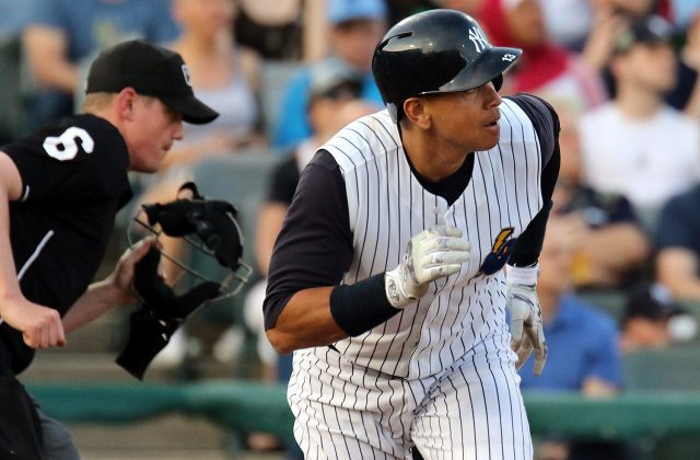 New York Yankees slugger Alex Rodriguez watches the ball go over the wall in center field as he begins his trip around the bases in the second inning at ARM & HAMMER Park in Trenton on Wednesday, May 25, 2016 during a game against the New Hampshire Fisher Cats. Rodriguez joined the Double A Yankee farm team for a second day as part of a rehab assignment. Photo by Martin Griff