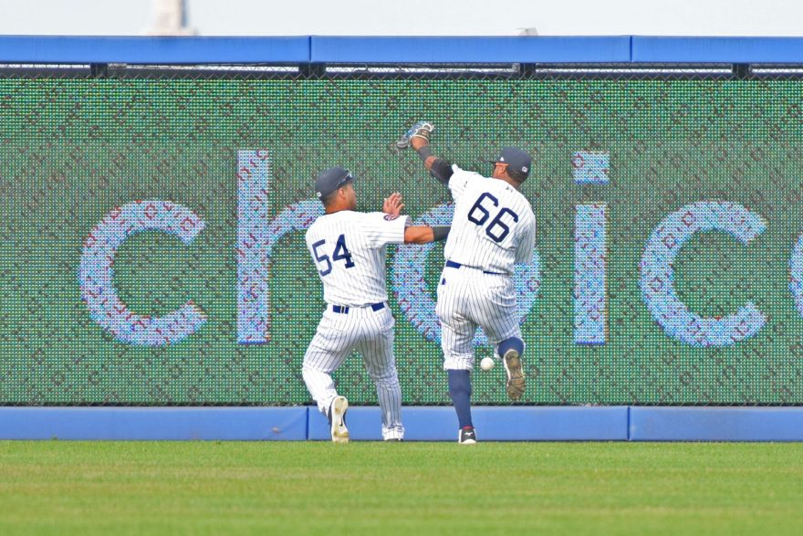 Dom Thompson-Williams and Ricardo Ferriera almost collide in right-center field on a base hit in the top of the second inning. (Robert M. Pimpsner)