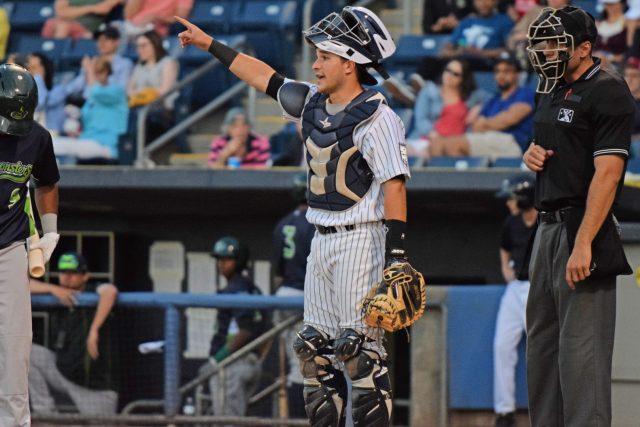 Luis Torrens signals to the Staten Island Yankees defense (Robert M. Pimpsner)