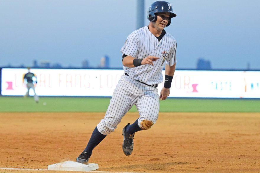 Luis Torrens rounding third base to score on an errant throw. (Robert M. Pimpsner)