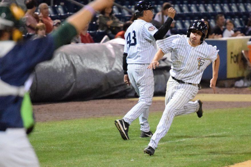 Nick Solak rounding third base on his way to score in the sixth inning (Robert M. Pimpsner)