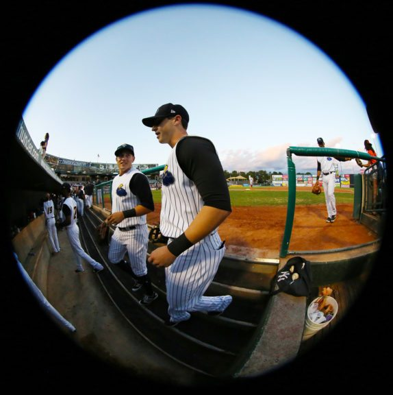 Trenton Thunder's Mark Payton and Dustin Fowler enter the dugout from the outfield against the Reading Fightin Phils in Game 1 of the Divisional Series of the Eastern League Playoffs at ARM & HAMMER Park in Trenton on Wednesday, September 7, 2016. Photo by Martin Griff