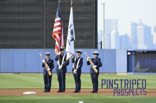 Members of the US Coast Guard present the colors prior to the game (Robert M. Pimpsner)