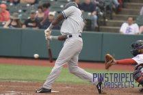 Jhalan Jackson drives the ball to right field for a 2-RBI double (Robert M. Pimpsner)