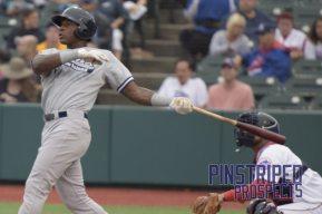 Jhalan Jackson follows through on his swing on a monster homerun (Robert M. Pimpsner)