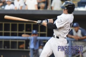 First round pick Kyle Holder connects for a base hit (Robert M. Pimpsner)