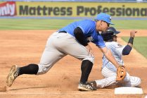 Thairo Estrada tagged out at third in the third inning (Robert M Pimpsner)