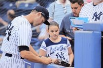 Staten Island manager Pat Osborn signing autographs for a young fan. (Robert M Pimpsner)