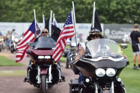Members of Rolling Thunder parade on the field prior to Military Appreciation Day (Robert M Pimpsner)