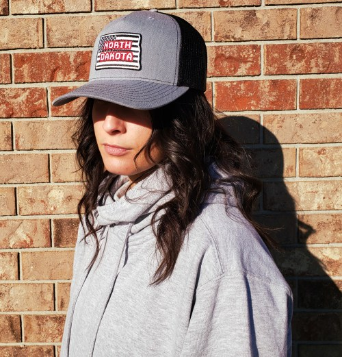 North Dakota ND American Flag Trucker Cap Ladies Model