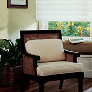 The chair's espresso finish looks beautiful with the beige upholstery.