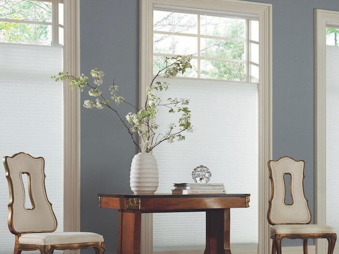 white vase flowers formal room chairs