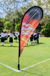 Pipe Bands Queensland promotional flag at the 2018 Australian Pipe Band Championships