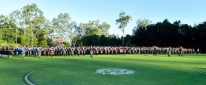 Massed pipes and drums march on the Brisbane Boys' College oval as part of the 2018 Australian Pipe Band Championships.