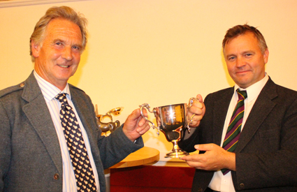 First day winner Stuart Liddell receives the Former Winners' MSR trophy from Piping Steward Jamie Mellor