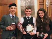 Principal prizewinners Joshua Townsley (Jigs), Ewan Murray (Ceol Mor) and Brighde Chaimbeul (MSR)