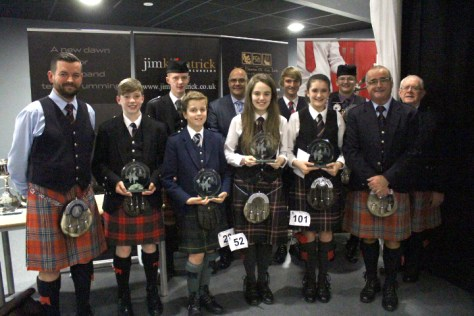 First prizewinners and officials at the closing ceremony