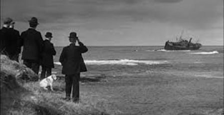 A scene from 'Whisky Galore'....islanders look on as the SS Politician and her golden cargo founders