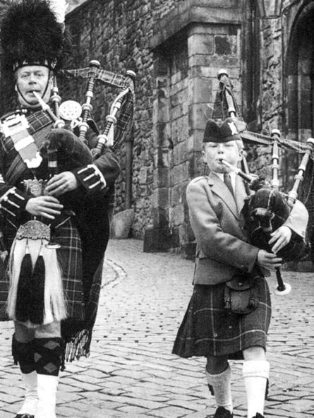 Like father like son...Norman and Alasdair on parade at Edinburgh Castle