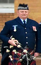 Brian Niven with medals