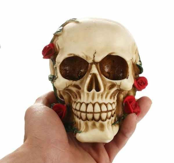 Holding flower skull statue