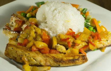 Mahi-Mahi topped w/ sautéed mango, coconut jasmine rice and mixed vegetables