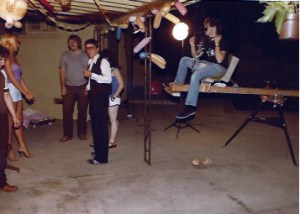 """Cinematographer Craig Bassuk sitting on his home made crane, with director Mark Pirro before him on the set of """"A Polish Vampire in Burbank"""" (1983)"""