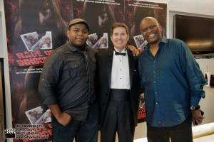 Actors Keeshan Giles, John McCafferty and Tyrone Dubose in front of Rage of Innocence poster