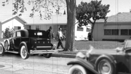 actors walking along vintage neighborhood in Pirromount's Celluloid Soul