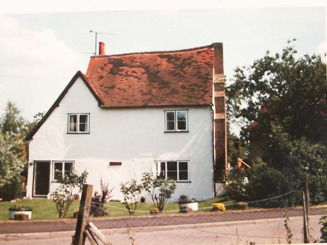 The original hall is on the left hand side gable end on to the road and is at a much lower height than the new wing which is two and a half storeys in height.