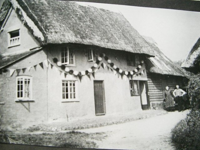 The cottages decorated for the Silver Jubilee in 1935. May 6th was the date when the Silver Jubilee of King George V and Queen Mary was celebrated. A church service followed by a fancy dress procession and teas for the children and the elderly brought a day to remember