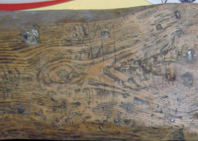 Apotropaic mark on the fireplace beam.