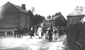 Photo of a fancy dress procession coming up the High Street