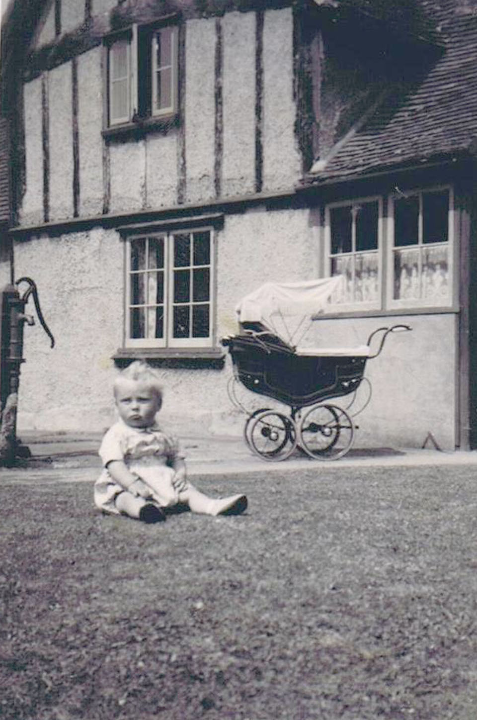 Stephen Lake outside his grandma's [ Miriam Weedon ]house.
