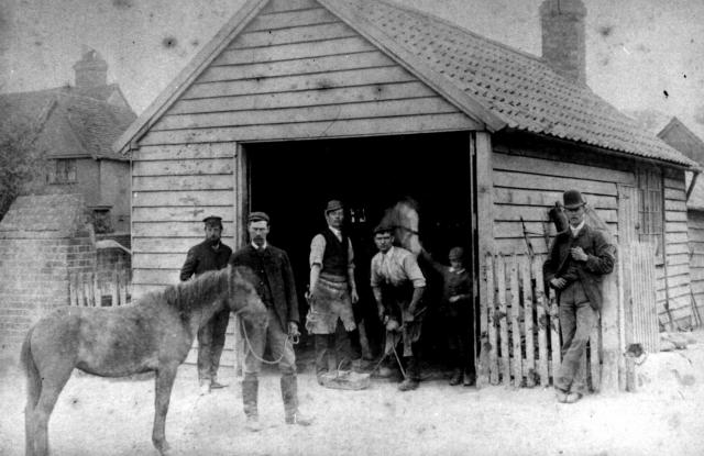 William Newbery and Freddy Bell at the Blacksmith's shop on Great Green