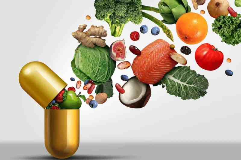 whole food vitamin showing vegetables and fruits flying into a pill capsule to help you get pregnant.