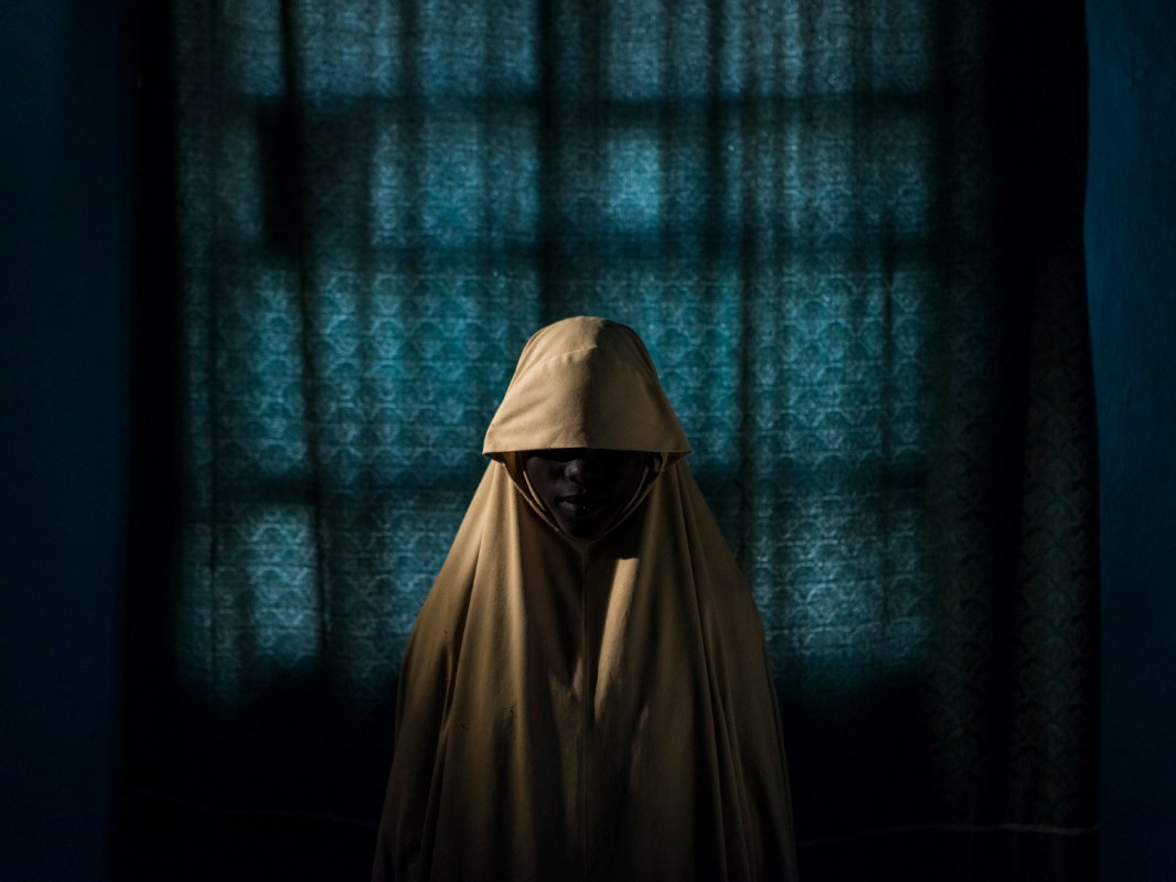 'Boko Haram strapped suicide bombs to them. Somehow these teenage girls survived' for The New York Times . Aisha, age 14