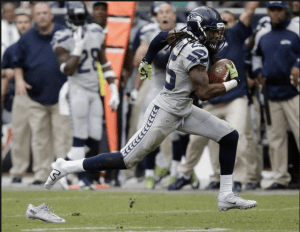 Shoeless Sherman runs his interception back-and leaves something behind